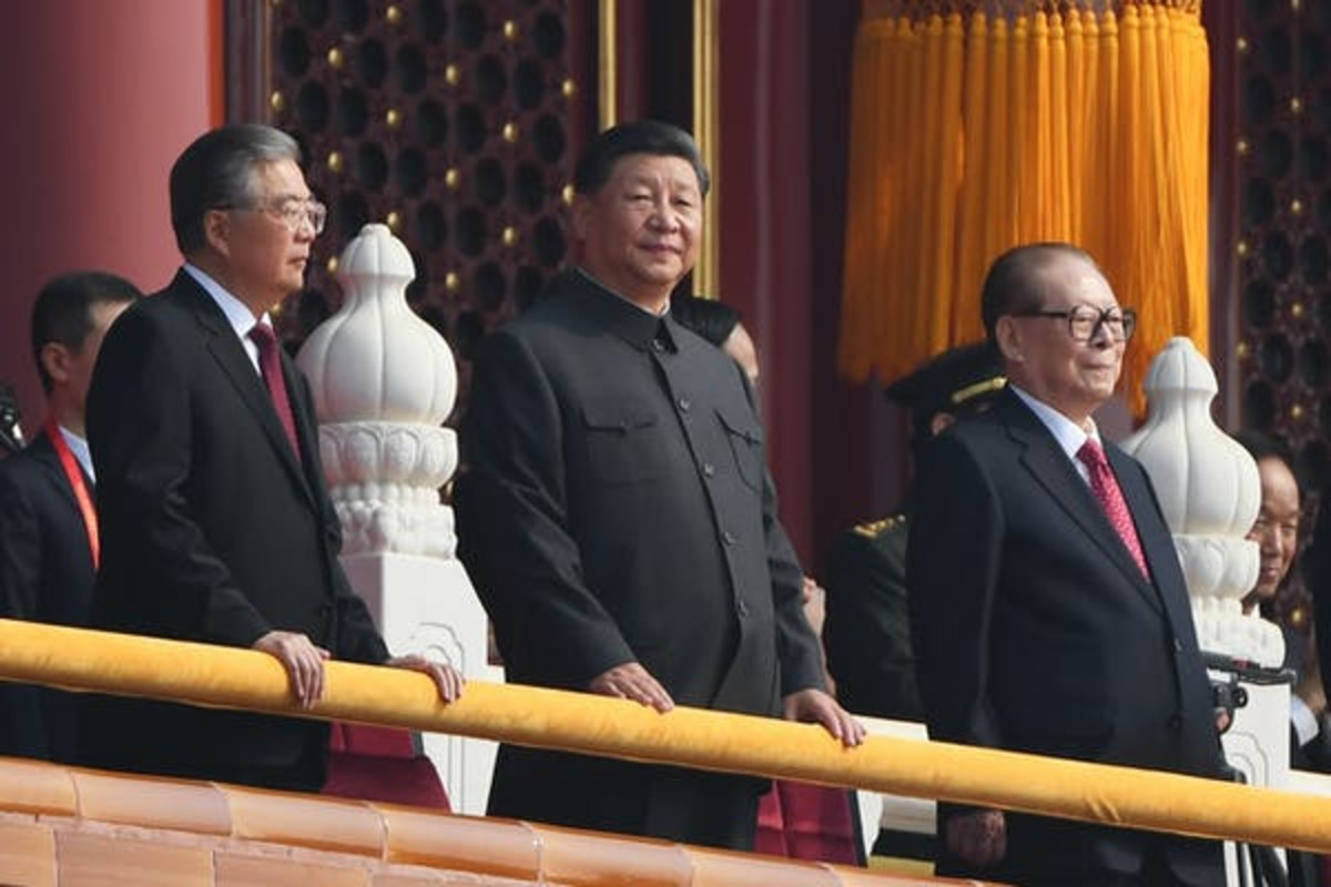 Chinese President Xi Jinping attends a military parade with former Presidents Hu Jintao, left, and Jiang Zemin in Tiananmen Square in Beijing on Oct. 1, 2019. Greg Baker/AFP via Getty Images