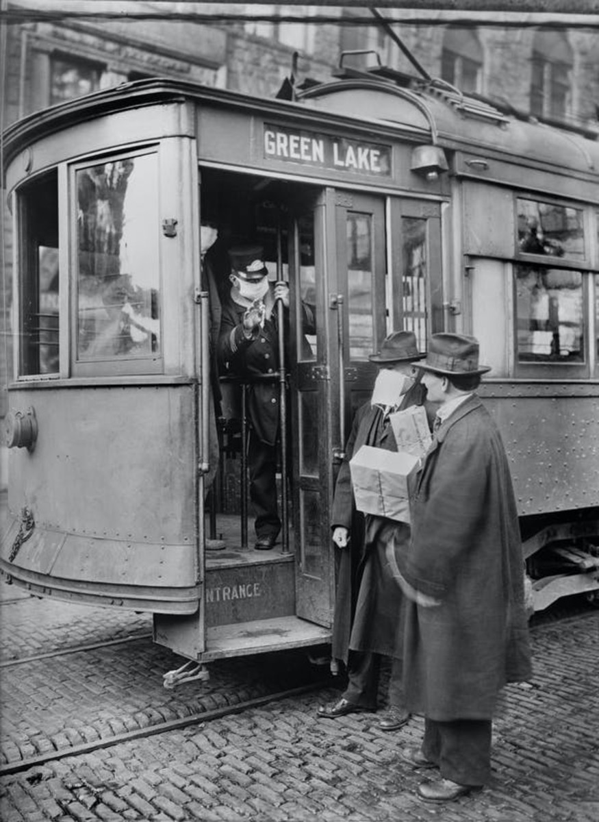 No mask, no service on streetcar in 1918. Universal History Archive/Universal Images Group via Getty Images