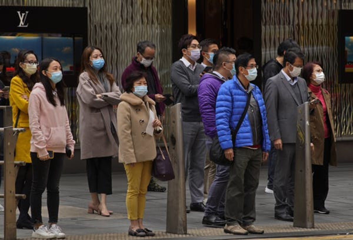 People in Hong Kong, concerned about coronavirus spreading from mainland China, wear face masks in February 2020. AP Photo/Vincent Yu