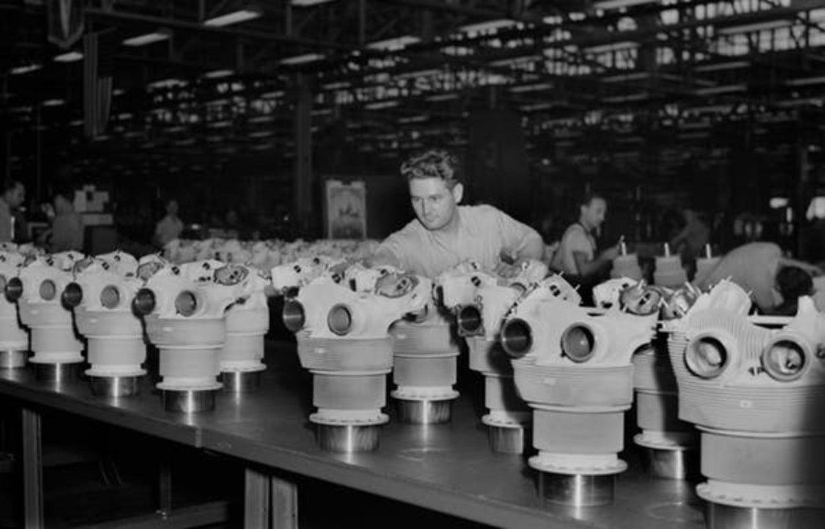Workers at an Illinois Buick car plant converted for war production line up cylinder barrels for quality control inspection in 1942. GHI/Universal Images Group via Getty Images