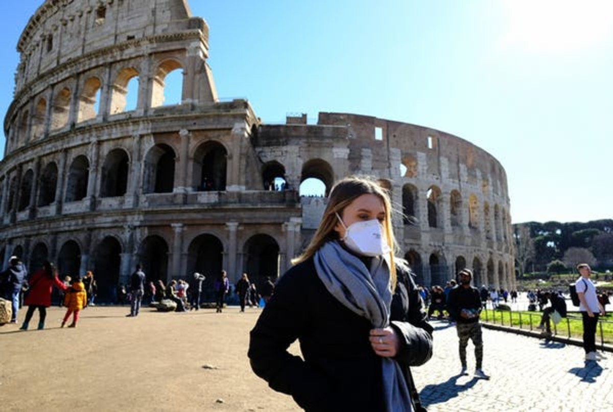 A tourist outside the Colosseo monument in downtown Rome. Italy has recorded the highest death toll. Andreas Solaro/AFP-GettyImages