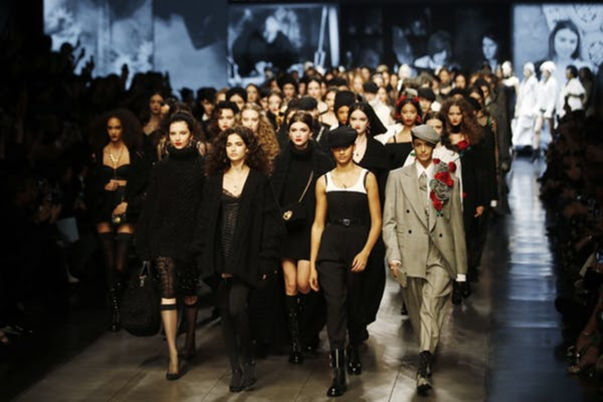 Milan's Fashion Week drew models, designers and other fashion professionals from around the world, even in late February 2020. AP Photo/Antonio Calanni