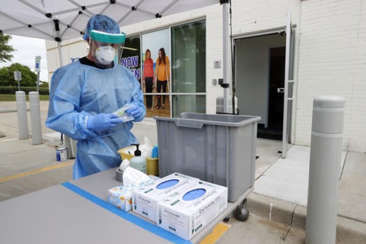 A nurse prepares a COVID-19 testing kit in Richardson, Texas. AP Photo/Tony Gutierrez