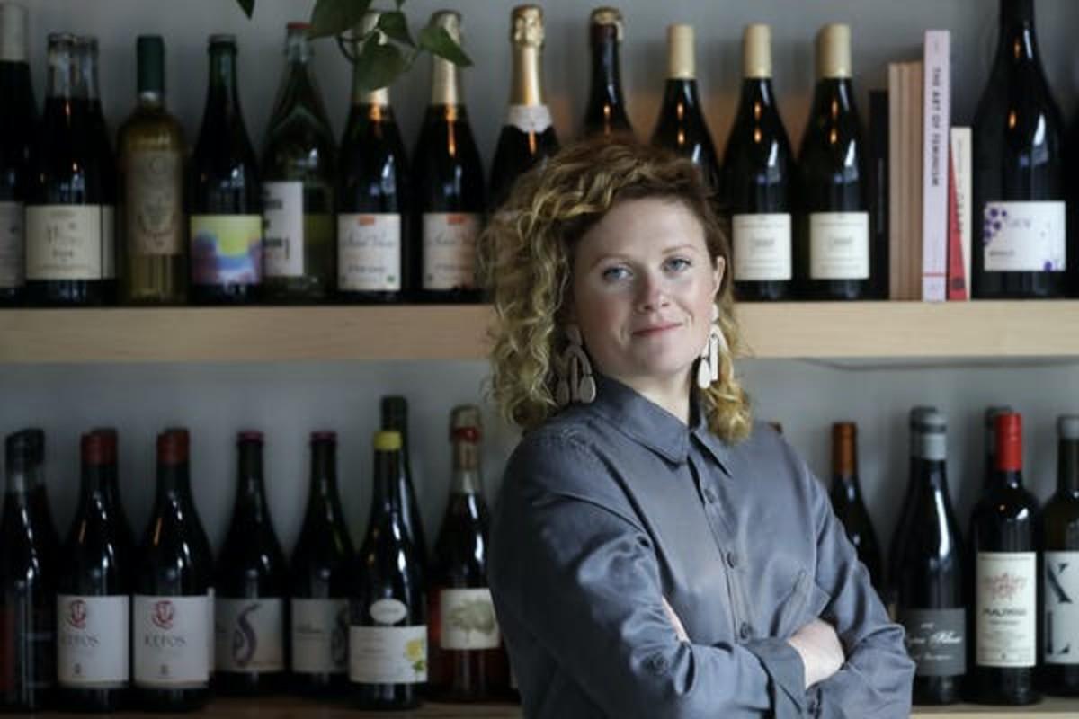 Lauren Friel, owner of Rebel Rebel Wine Bar in Somerville, Mass.,worries there will be less stimulus money for smaller businesses like hers. AP Photo/Steven Senne