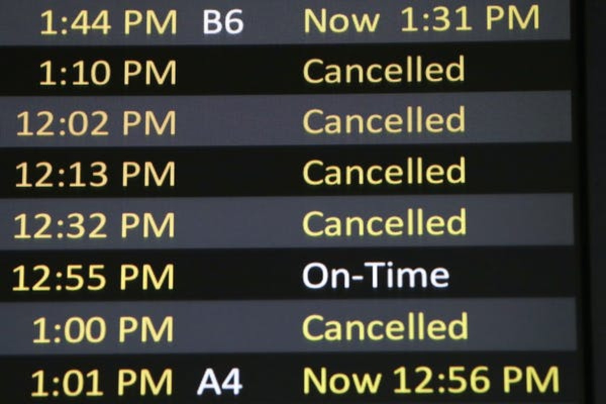 A board listing arrivals lists a number of canceled flights at Seattle-Tacoma International Airport on April 15. AP Photo/Elaine Thompson