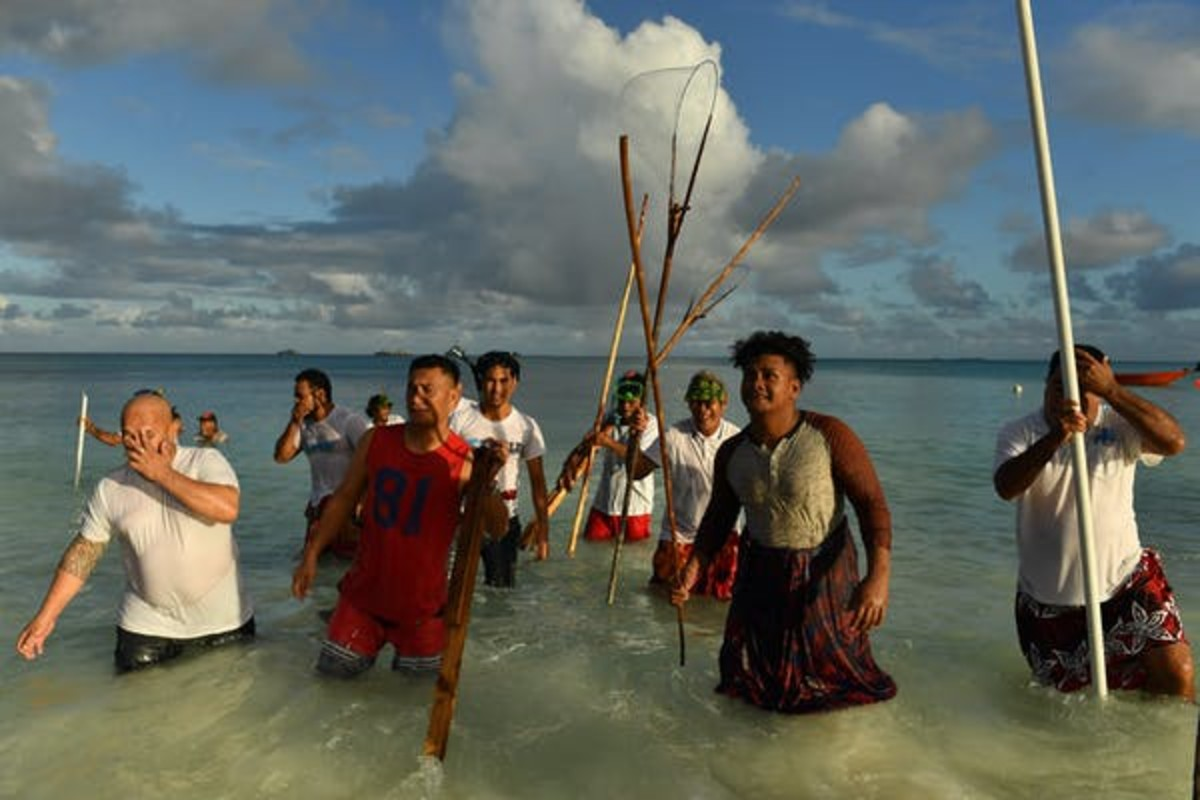Locals in Tuvalu, a Pacific island nation vulnerable to climate change. Like coronavirus, global warming does not respect borders. Mick Tsikas/AAP