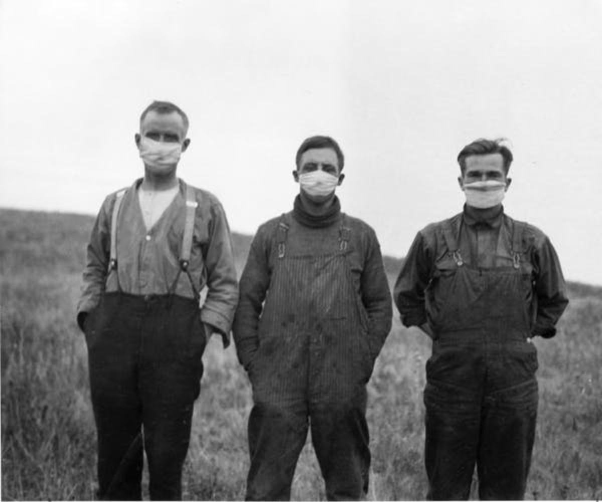 Men wear masks in Alberta during the influenza pandemic of 1918. Second and third waves of the flu added to economic woes in the early 20th century. THE CANADIAN PRESS/National Archives of Canada