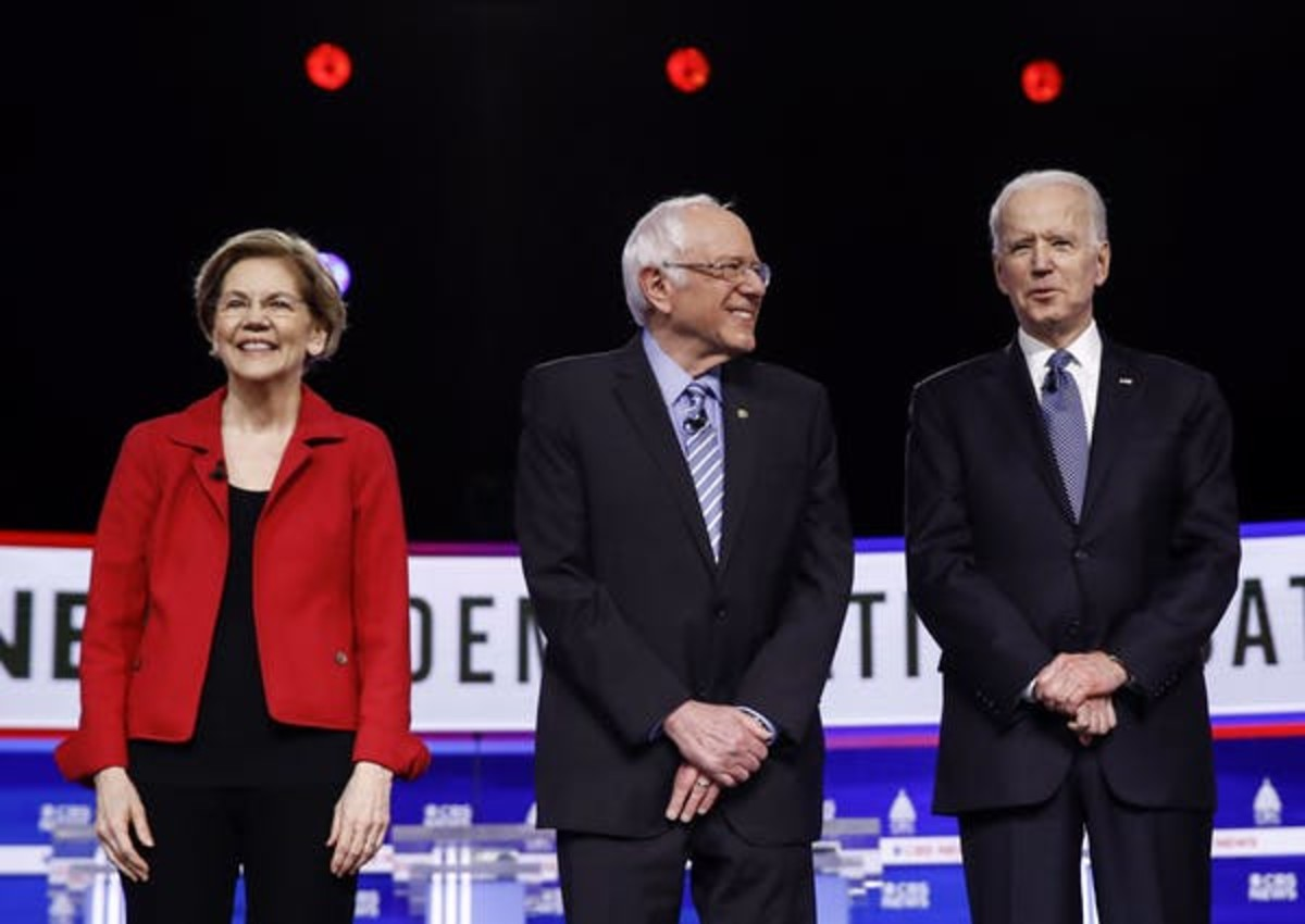 Democratic presidential candidate Joe Biden (right) has supported policies that would limit greenhouse gases and set the U.S. economy on a path to a low-carbon future. (AP Photo/Matt Rourke)