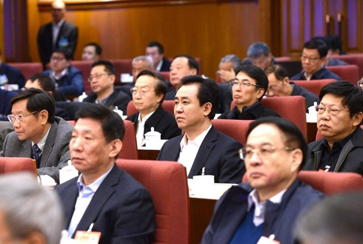 Evergrande's founder Hui Ka-yan (centre), seen during the 18th Session of CPPCC's 12th Standing Committee meeting in Beijing. Photo: Handout