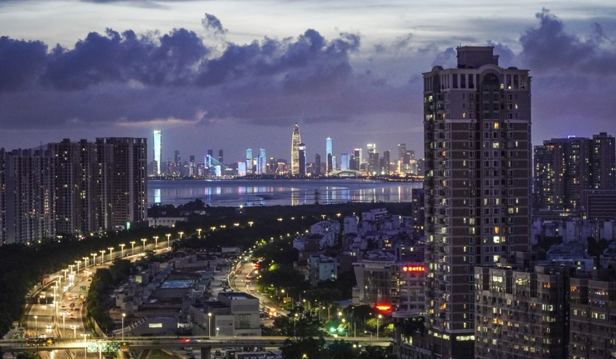 The Beijing-Hong Kong-Macau expressway lights up with the Nanshan district in the back taken from the Futian district of Shenzhen, one of 11 cities included in the Greater Bay Area project. Photo: SCMP/Roy Issa
