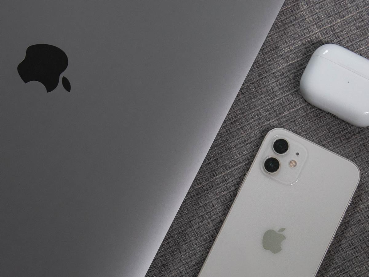Figure 1: Apple's MacBook, iPhone and AirPods Pro.