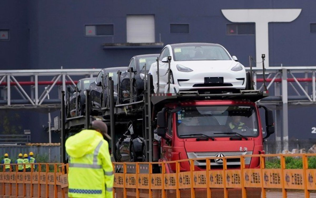 China's EV War: Tesla's May Deliveries Of Electric Cars Rise 30 Per Cent As Delivery Backlogs Shield It From Home-grown Rivals