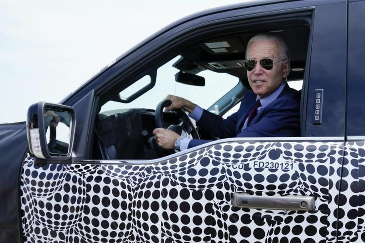 President Joe Biden, a self-described 'car guy,' drives a test model F-150 Lightning truck at Ford's Dearborn Development Center on May 18, 2021. AP Photo/Evan Vucci