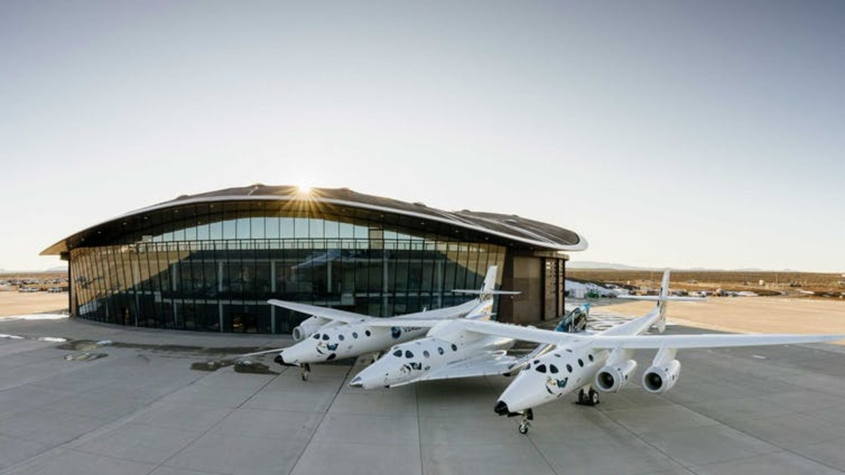Virgin Galactic's SpaceShipTwo shown attached to its carrier aircraft, WhiteKnightTwo, outside Spaceport America in New Mexico, the world's first commercial spaceport. Virgin Galactic