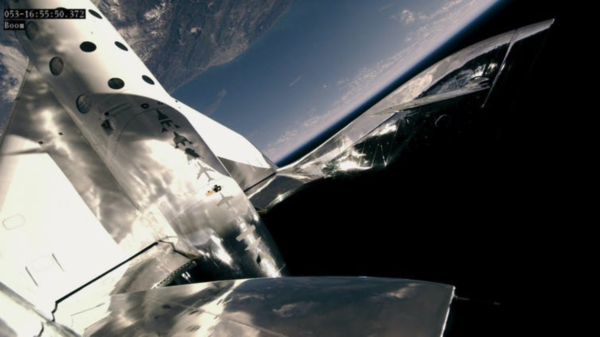 VSS Unity in space during a test flight, with its wings stowed away in preparation for feathered re-entry. This specific model has completed 21 successful test flights, with three reaching space.