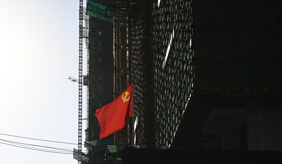 A Communist Party flag is seen at the construction site in Zhumadian, central China's Henan province. China's property sector has come under particular scrutiny as the Communist Party marks its centenary. Photo: AFP