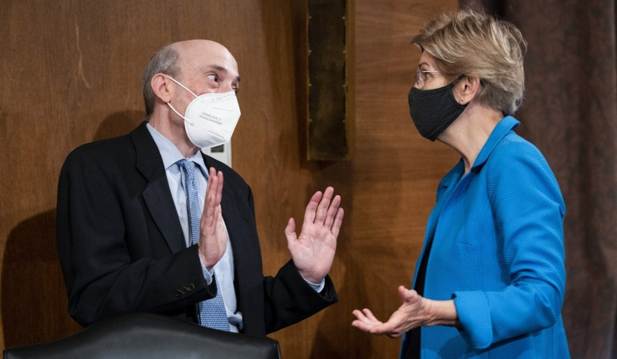 Senator Elizabeth Warren, Democrat of Massachusetts, speaks with SEC Chairman Gary Gensler before the oversight hearing on Tuesday. Photo: AP