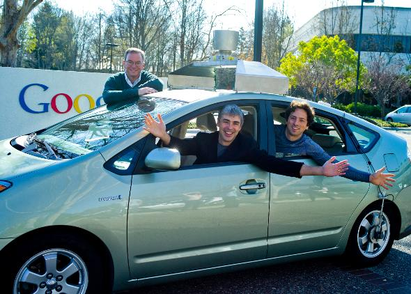 Google Founders Larry Page, and Sergey Brin in one of their early self-driving cars